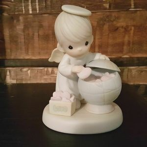 """Precious Moments Figurine """"What The World Needs is"""
